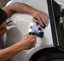 Кузовной ремонт: как выправить вмятину на авто без покраски? фото